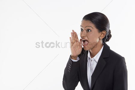 Malaysian indian : Businesswoman showing a whispering hand gesture