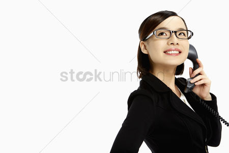 China : Businesswoman smiling and talking on the phone