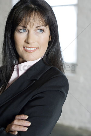 Satisfaction : Businesswoman smiling while thinking