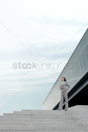Steps : Businesswoman standing on the stairs