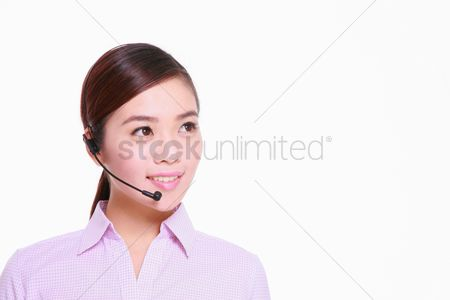 Technology background : Businesswoman talking on telephone headset