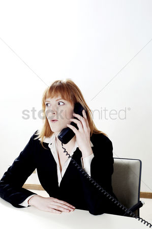 Wondering : Businesswoman talking on the phone
