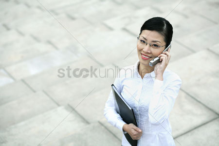 Stairs : Businesswoman talking on the phone