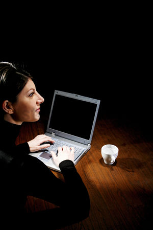 Lying forward : Businesswoman thinking while using laptop