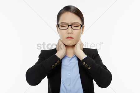 Pain : Businesswoman touching her neck
