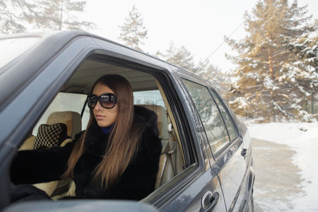 Cold temperature : Businesswoman traveling in the car
