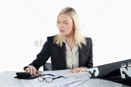 British ethnicity : Businesswoman using calculator