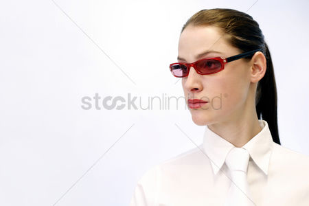 Determined : Businesswoman wearing a red funky sunglass