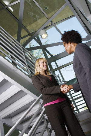 Steps : Businesswomen shaking hands