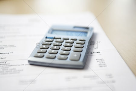 Business Finance : Calculator lying on telephone bill close-up