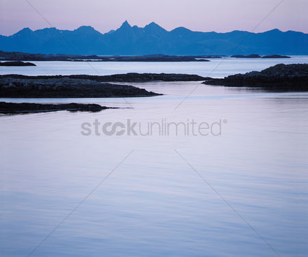 Remote : Calm water and distant mountains
