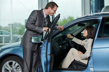 Car : Car salesperson explaining car features to customer