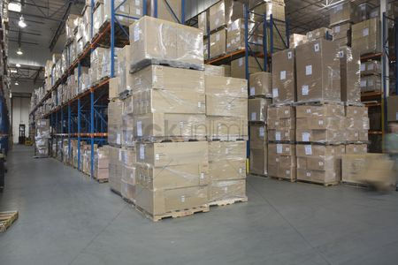 Interior : Cardboard boxes stacked in distribution warehouse