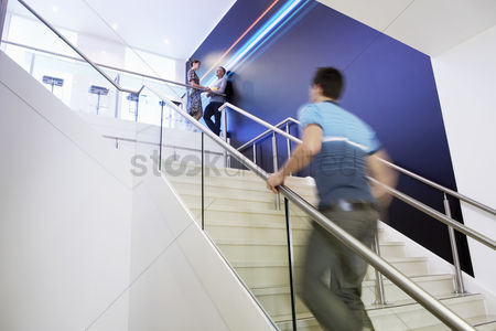Staircase : Casually dressed businessman walking up stairs side view
