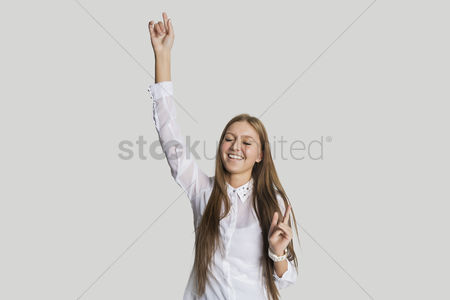 Dancing : Cheerful woman dancing against white background
