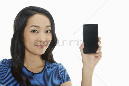 China : Cheerful woman holding up a mobile phone