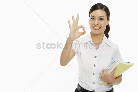 Study : Cheerful woman showing hand gesture