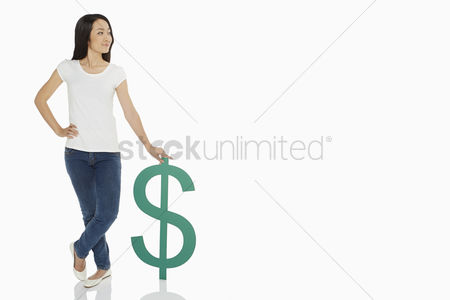 Asian : Cheerful woman standing with a dollar sign