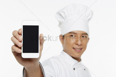 Masculinity : Chef holding up a mobile phone