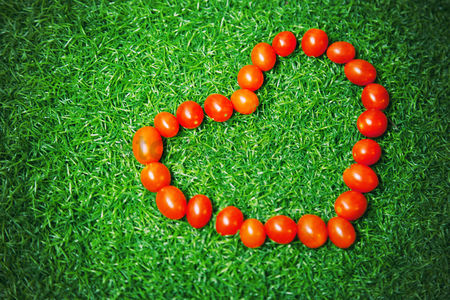 Grass : Cherry tomatoes forming heart shape