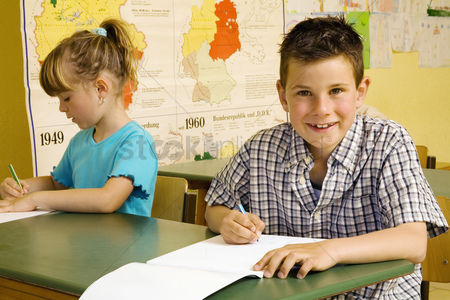 School children : Children colouring in the classroom