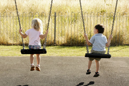 School children : Children on swings