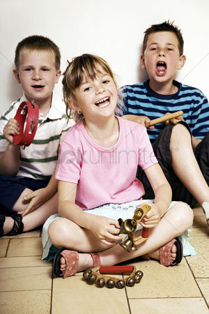 Children playing : Children singing while playing musical instrument