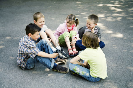 School : Children sitting in a circle playing