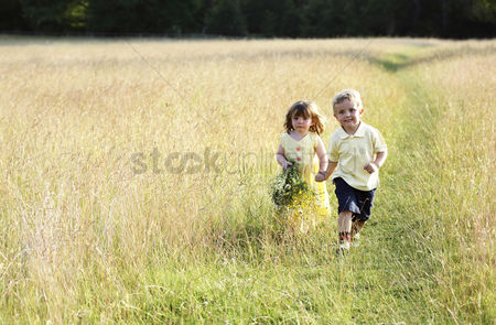 Love : Children wandering in the meadow