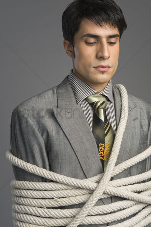 Forbidden : Close-up of a businessman tied up with ropes