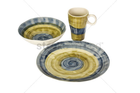 Mad : Close-up of a ceramic bowl with a cup and a plate