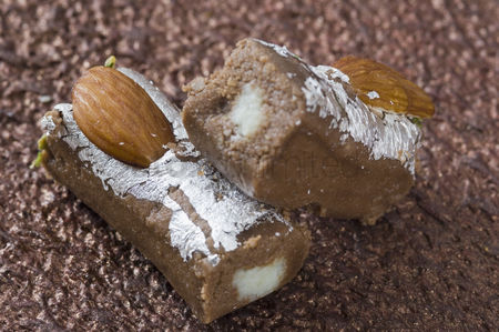Almond : Close-up of a chocolate roll garnished with almonds