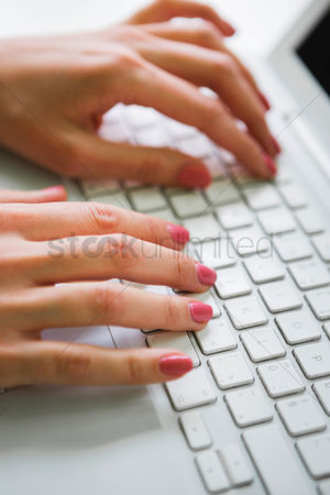 Businesswomen : Close-up of businesswoman using laptop