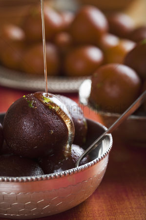 Diwali : Close-up of gulab jamuns  a popular traditional indian sweet  in a bowl