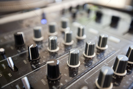 Dance : Close up of knobs on audio console