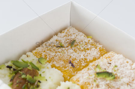 Almond : Close-up of moong daal burfi in a box
