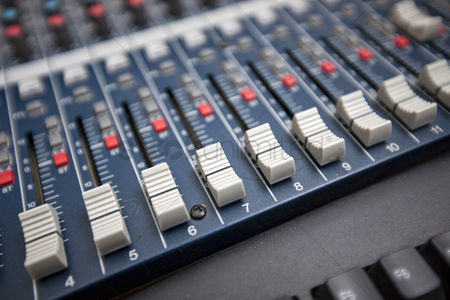 Technology background : Close-up of sound mixing equipment in television studio