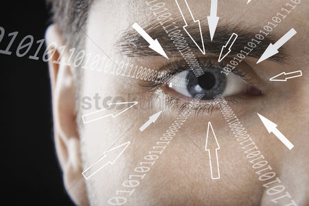 Black background : Close-up portrait of businessman with binary digits and arrow signs moving towards his eye against black background