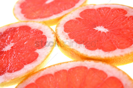 Spring : Closeup of sliced grapefruit on white background