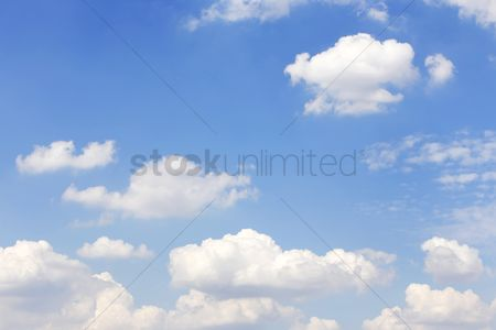 Background : Clouds against the clear blue sky