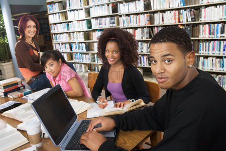 College : College students studying together in library