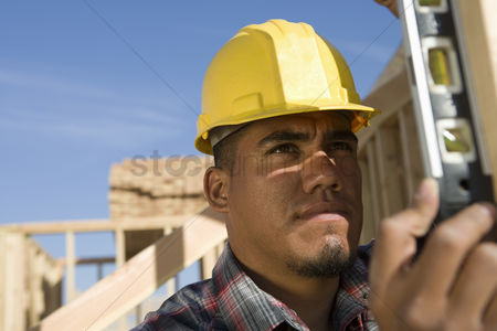 Spirit : Construction worker using spirit level