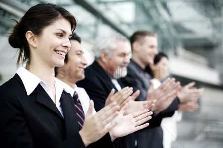 Business suit : Corporate people clapping hands
