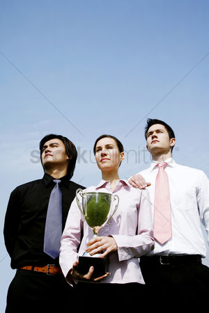 Motivation business : Corporate people with their trophy