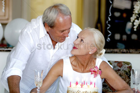 Celebrating : Couple celebrating birthday