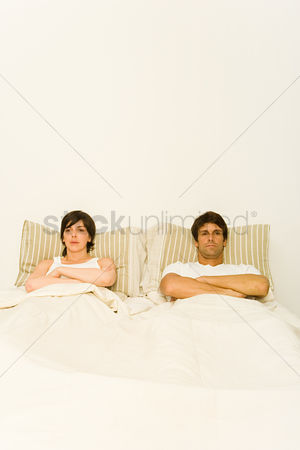 Ignorance : Couple in bed ignoring each other