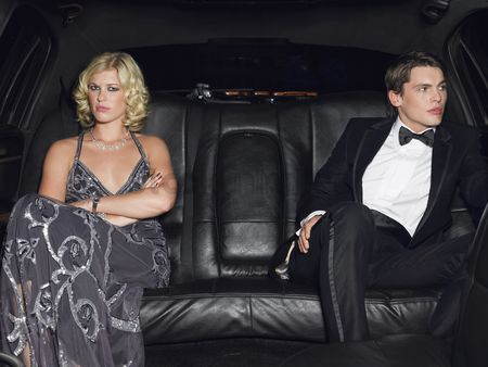 Moody : Couple in evening wear in back of car