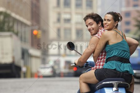 Posed : Couple on motor scooter