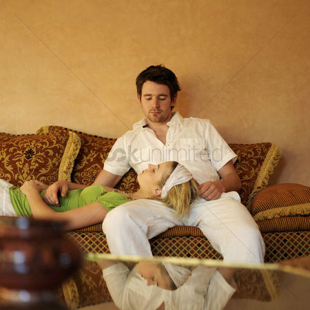 Sitting on lap : Couple relaxing on the couch