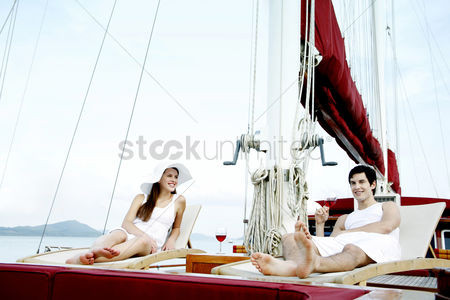 Transportation : Couple relaxing on the lounge chair